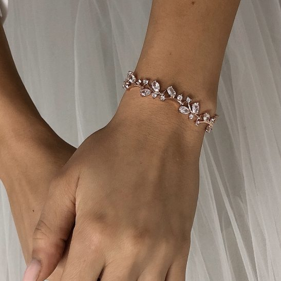 Whether a statement piece or a fine bridal bracelet, our AAA grade Cubic Zircon bracelets are the perfect finishing touch to your wedding ensemble. Your wedding bracelet will sparkle brilliantly as you cut the cake, toast to your wedding and of course put the wedding band on. The crystals, cut like diamonds are the finest quality and finished in Rhodium (nickel free) metal. We can custom the length to fit your wrist size. Just mention the length you need when ordering.