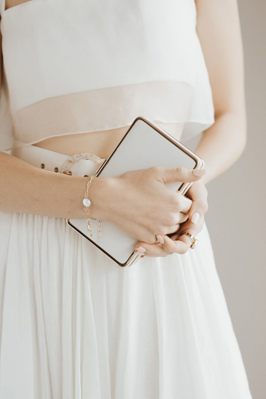 With charming simplicity this bridal clutch suits the modern and refined bridal look that is so on trend at the moment. For a bride, one of the signature moments of the wedding day is when she puts on her accessories, it's like the pause before the big event. Hold all your essentials in this minimal clutch that perfectly complements your dress and accessories without stealing the show. This clutch comes with a removable chain shoulder strap.