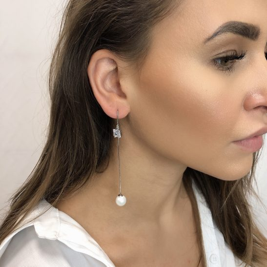 A simple yet unique designed thread earring, thats adds that extra something to any look. There are many leangth options by adjusting the thread position, or wear as pictured with the Cubic Zircon worn high with the pearl hanging lower. The pearl pulls off the thread, making the earring easy to put on and off while still secure on the ear.