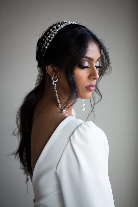 What a stunning headband to complete the modern bride vibe. You too can look like you've come straight off the pages of Vogue, Elle and Harpers Bazarr best dressed/accessories list. Made of high grade crystal based pearl and gold chain that are strung together off a gold headband base. 14 plus strands hang at 45cm in length. This piece appeals to a confident woman that knows what it feels like to be complimented on her style and taste. Picture shows product but they can be custom made to 0length, colour and metal finish. Please get in touch if you have special requirements.