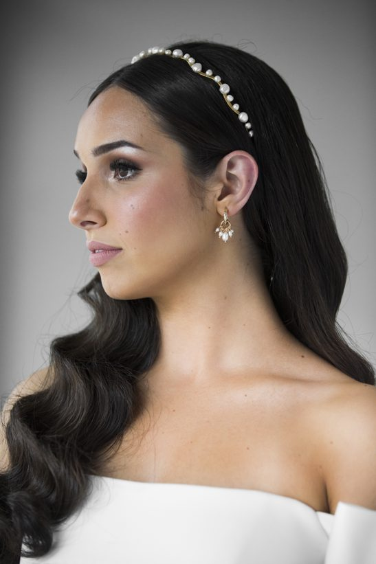 These small hammered gold hoop earrings with fresh water pearl cluster drop, are tasteful and understated. Matching well with almost any bridal look they are versatile and very fashionable for today's modern bride, or an equally good choice for your bride tribe. As a wedding accessory you couldn't wish for a more beautiful creation.