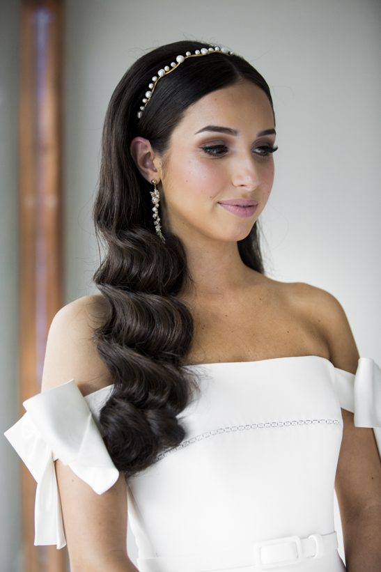 A long gold strand with fresh water pearls makes up this intricate pair of earrings. You are sure to receive many positive compliments with these stunners that are crafted with care and skill. A beautiful bridal accessory for the modern bride.
