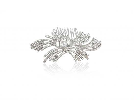 We love this eye catching bridal headpiece filled with diamante crystals on a silver metal base, and you will too. It sparkle brilliantly as you move attracting compliments from all who see it. It can be worn in many hair styles, but our brides tend to prefer it tucked into the side of a messy up, or behind the ear with hair out. The crystals shine brightly in this stunning hair piece, accented off the rhodium silver base and classic art deco design.