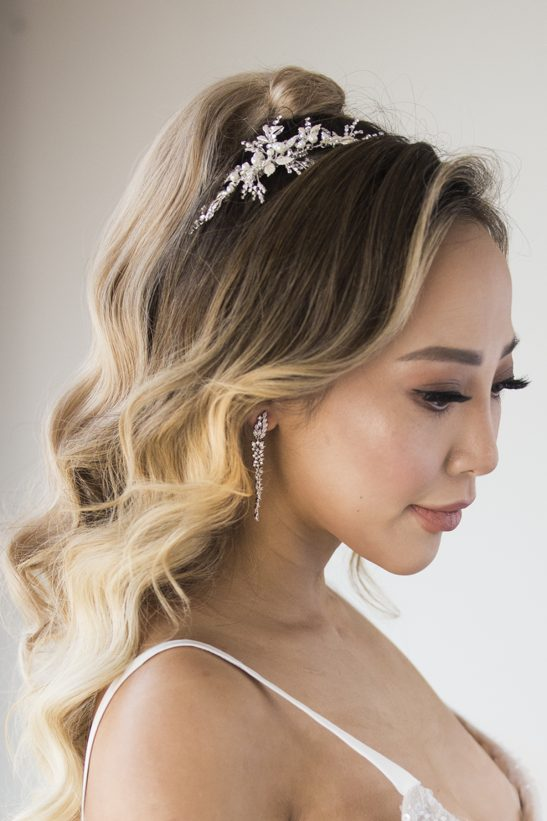 For the lovers of all things soft and romantic, this piece adds such beauty and grace to your big day. Pearls and crystals set in a champagne gold base create the intricate details that you will cherish long after your wedding day. The natural elements of this bridal headpiece creates the most beautiful silhouette that exudes an effortless elegance, and can be pinned into the side of your hair or centre back is choosing a half up bridal hair style.