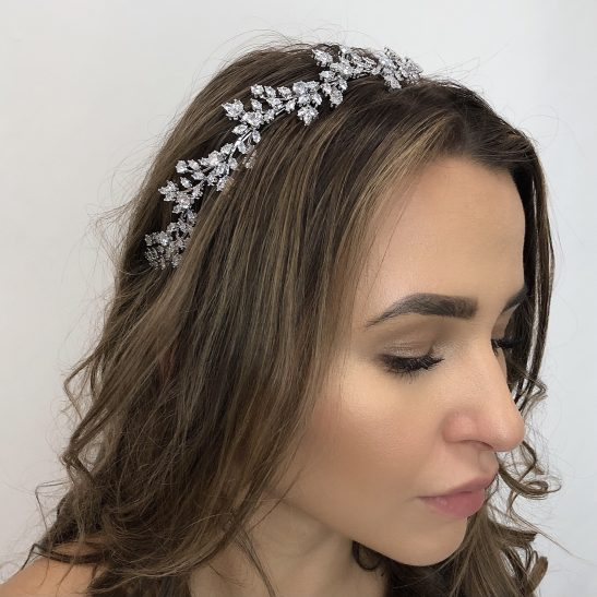 We love the affect created with various shaped crystals that are meticulously assembled with the finest grade cubic zirconia. Individually hand set, just like diamonds, their brilliance will shine bright, catching the light as you enjoy your wedding day. The intricate details of this bridal headpiece will be appreciated by the discerning bride and is a stunning addition to your wedding look evoking a confidence that lets you shine inside and out.