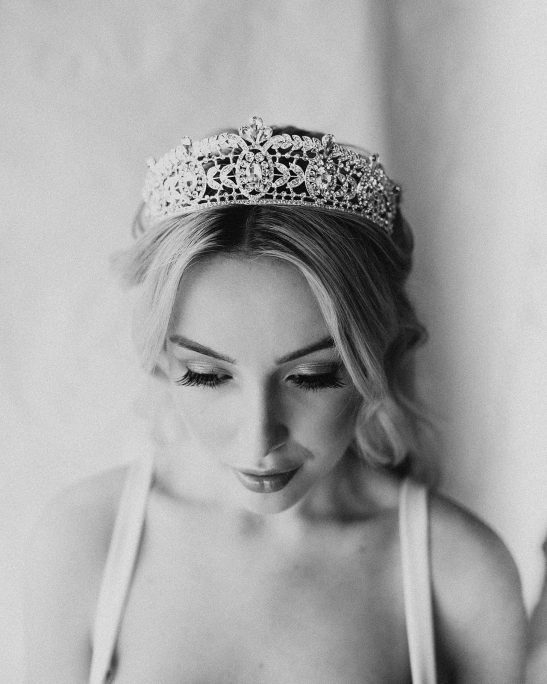 With a styled chignon hairdo or loose waves, this bridal crown adorned with high-quality crystals in alluring shapes, will look like pure perfection. The thick band of crystals stands out with dazzle and elegance and features a modern design.