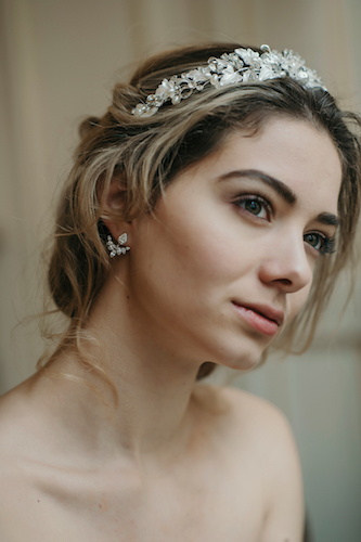 These classic bridal earrings in crystal and silver have a modern twist with a design that is interesting and eye-catching. A classic crystal shape sits on top of a chic v shaped arrangement of gems. For the bride aware of high fashion but also appreciating the beauty of classic looks this pair of earrings is perfect.