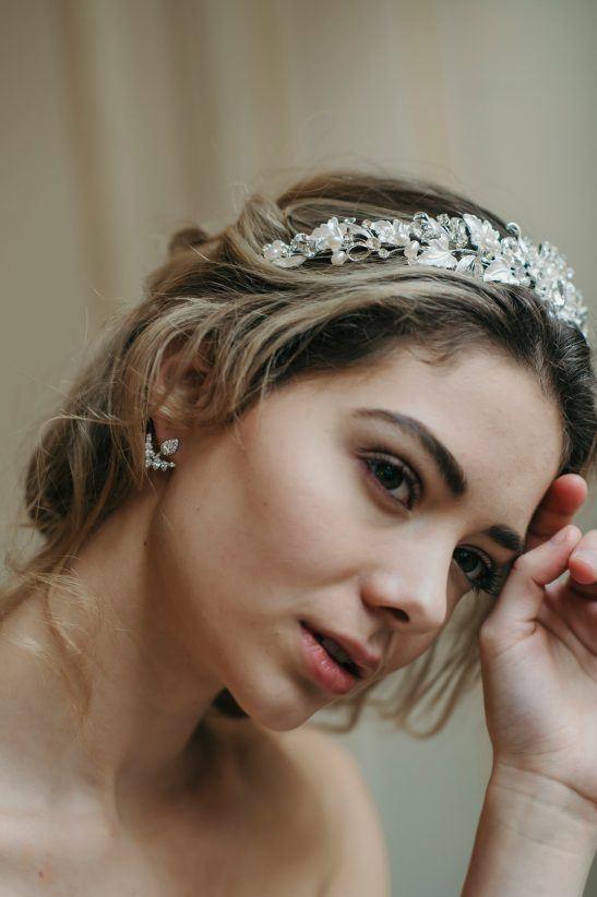 Beautiful details are created by entwining pearls, crystals and flowers to form this stunning silver bridal floral crown. This 'on trend' bridal headband can be worn in many hair style variations, and is the perfect addition to your wedding look or hens night. Fresh water pearls and swarovski crystal pop out amongst the flowers, reminiscing of a cottage garden, and really add a beautiful depth and texture to the silver flower crown.