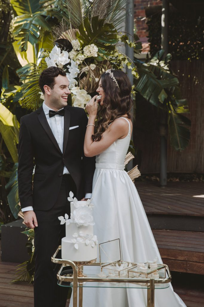 bride wearing a KWH bridal dress and Jeanette Maree headpiece