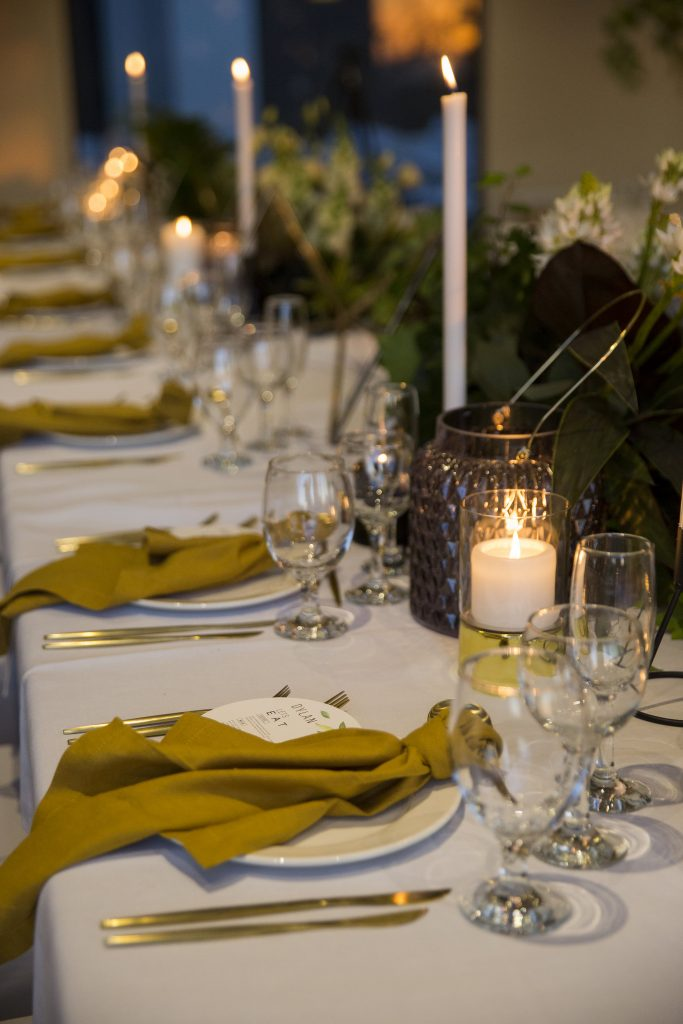 black gold and white wedding table setting
