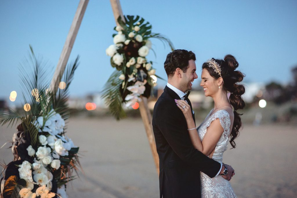 triangle arbour with bride and groom on brighton