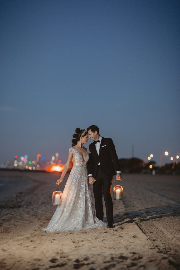 bride and groom on beach at sunset in Melbourne